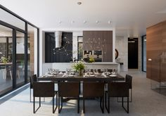In the dining room, sliding glass doors open out onto a patio, which has its own outdoor entertaining space. Over the dining room as well as the living room, creative light fixtures capture your attention with sparkle and shine.