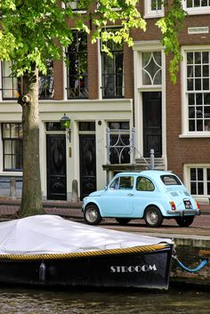 Blue Fiat, Amsterdam by amy coady; you have to love a city that mixes boats and cars like this!