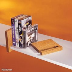 To corral shelf-dwelling books or DVDs that like to wander, cut 3/4-in.-thick hardwood pieces into 6-in. x 6-in. squares. Use a band saw or jigsaw to cut a slot along one edge (with the grain) that's a smidgen wider than the shelf thickness. Stop the notch 3/4 in. from the other edge. Finish the bookend and slide it on the shelf. Want to build the shelves, too? We've got complete plans for great-looking shelves here.