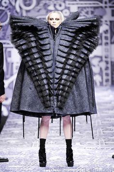 """I found this under """"fall Fasion"""" Seriously, where would ANYONE ever where that to?Space Adventure? Playing the evil overlord in an 80's movie? ----- Kristen McMenamy wearing Viktor & Rolfe Huge Glamour Factory coat Black A/W 2010"""