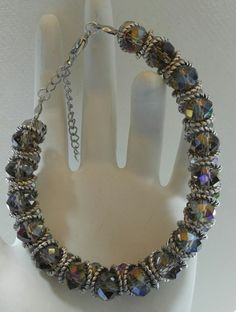 """Beauful electoplated smoke color glass crystals with a hint of purple, silver and gold when in direct light  7 3/8"""" long with 2"""" extender chain 