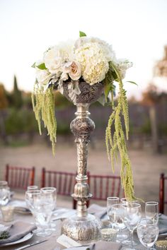 #amaranthus #centerpieces Photography by ashleightaylorphotography.com Planning by nataliesoferweddingsandevents.com Floral Design by toastsantabarbara.com Read more - http://www.stylemepretty.com/2012/11/29/santa-ynez-wedding-at-sunstone-winery-from-ashleigh-taylor-photography/