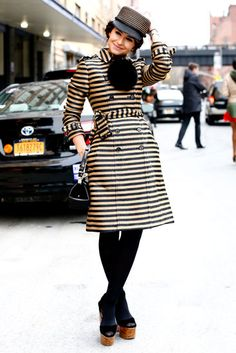 Miroslava Duma was equal parts dapper and cool in a striped trench and top hat. #NYFW #StreetStyle
