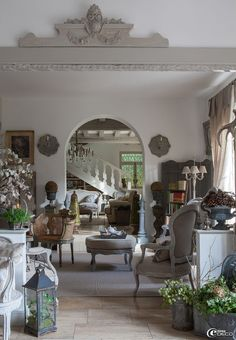 Wow! This French living room is so gorgeous. Old/new collectibles/antiques, architecture, soft colors