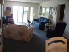 Living Room,(flowered chair no longer there) couch, loveseat and rocker/recliner