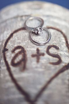 Rings on carved wood + woodsy wedding + country wedding Style Me Pretty | Gallery