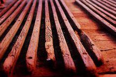 A photo taken of an old hardwood floor on a vintage tram #vintage #tram #old #wood #background #wallpaper #hardwood #floor #lines #nails