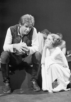 Harrison Ford and Carrie Fisher on the set of Star Wars.