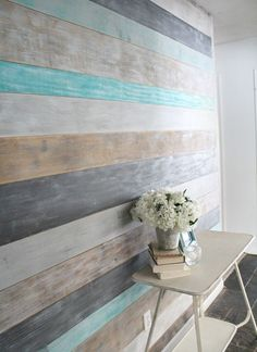 These walls would look really great on the clock walks. The walls are small enough for it to not be a huge project and they do not have outlets so it would be as simple and painting and placing the boards. This treatment would look awesome behind the manicurist stations and as a back accent wall in the bathroom as well. How to DIY a Wood Planked Accent Wall: DIY Wood Wall