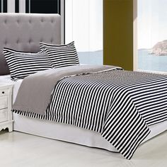 Add a fresh touch to your guest room or master suite with this cotton duvet cover set, showcasing a blue and white stripe motif.   P...
