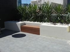 Image result for concrete wall wood seat top