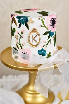 Pretty hand-painted birthday cake by Juniper Cakery