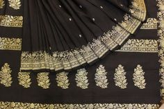 Material / Type   Benaras Silk Sari  Details   Length - 5.5 mts, Border Width - 8.3 in, Blouse - 85-90 cms  Shipping 3 to 5 days from Order Date  Colours   Black, Gold Colour Zari  Wash Instructions   Dryclean Only