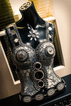 Mosaic mannequin torso, steampunk, female, mosaics paint and jewels.