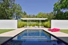 Contemporary Pool and Pergola With Minimalist Landscaping
