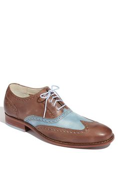 "Beautifully dressed up or down Cole Haan ""air colton"" Wingtip oxford.. Also comes in a tan w/ white style as well...Ask about free shipping and free and easy returns if needed!"