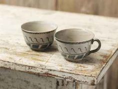 Bernard Leach (1887-1979)  Tokyo, 1913  Two earthenware cups decorated in a white glaze and painted in blue, one with a handle decorated in blue and grey glazes, signed BHL and dated 1913 in an octagonal chequered mark inside the foot-ring 5.5cm. and 5.6cm. high (2