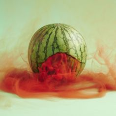 In the series 'Secret Lives', Polish photographer Maciek Jasik creates vibrant imagery of vegetables and fruits with colored smoke.