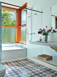 Bright bathroom with concrete and cement tiles