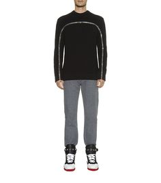 A contemporary layer from Givenchy, this sweater is crafted in a heavyweight black wool-blend and styled with a textural honeycomb knit. Two exposed zips, one to the front and one to the back, curve their way down the sleeves; a quiet reference to the brand's basketball inspirations for AW14. Wear this statement sweater on weekends with black jeans and high top sneakers. Model wears a size M RRP: £1,275,00 (HARRODS UK)