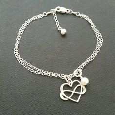 Great gift idea for your daughter on her wedding day. Entwined infinity heart bracelet in your choice of silver or gold finish. very dainty and