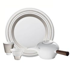 """In 2005, Hering Berlin brought out its first two dinner services. They immediately became the darlings of the avant-garde chefs who recognised the totally new stage the uncompromisingly modern plates offer for their own creative materpieces. This partially glazed """"Glamour"""" dinner service by Hering Berlin is handcrafted in biscuit porcelain and refined with fine platinum. First, the white, unglazed biscuit porcelain is smoothed and polished using a special diamond sponge"""