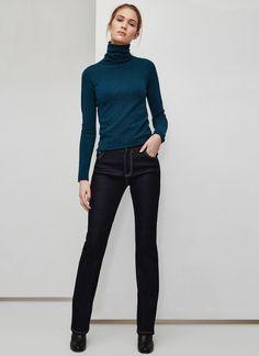 Classic blue turtleneck | Slim black trousers | Minimalist casual wear | Capsule wardrobe | Slow fashion | Simple style | Minimalist style | Stylish business casual | Scandinavian casual wear | Stylish work outfit by Adolfo Dominguez