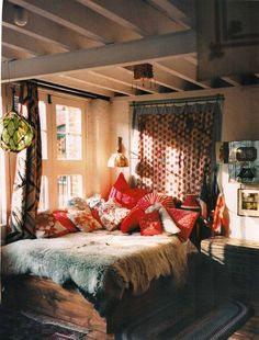 I like how the pillows are positioned and how there is a cute light above the bed