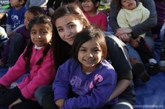 Los Angeles, California - Young adult volunteers spend time with disadvantaged children in the city of Los Angeles.   Take a moment today to pray for children in our own nation who are struggling with poverty. Pray especially for the nutritious food they need to grow and thrive.