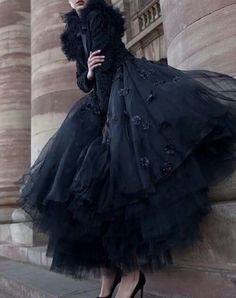 Layers of stunning, midnight black tulle paired with elegant black heels. Classy showstopper!