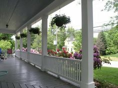 more square columns and lower railings.. could work on our porch...