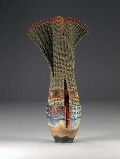 HEALING, REVEALING a collaboration between Marc Jenesel and Karen Pierce, mixed media of raku, woven seagrass, copper wire and foil, and smoked rattan. To see more of their incredible work go to clay-n-fiber.com