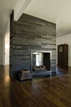 double sided fireplace: great combo of rustic grey reclaimed wood and warm distressed wood floors Home Fireplace, Fireplace Design, Grey Fireplace, Modern Fireplace, Basement Fireplace, Fireplace Ideas, Tiled Fireplace, Style At Home, Distressed Wood Floors