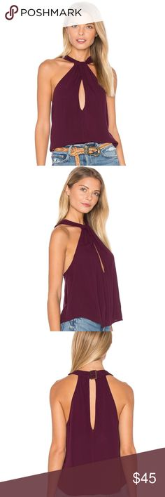 Free People Twist and Shout Tank (wine) New with tags!!! Super cute top just too big for me. The key hole in the front and buckle in the back around the neck make the cutest details for this shirt. Make a reasonable offer! Free People Tops Blouses