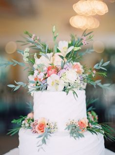 Rustic floral topped cake: http://www.stylemepretty.com/georgia-weddings/tybee-island-georgia/2016/02/06/classic-southern-wedding-at-the-chapel-from-the-last-song/ | Photography: Julie Paisley -  http://juliepaisleyphotography.com/