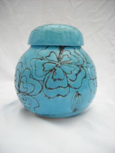Laura Wowk Pottery Egyptian blue glaze over black wax resist gourd jar.  Wheel thrown.