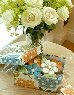 Very pretty flower cookies (Honeycat Cookies). Love how they match the box!