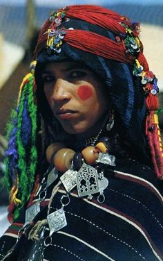 Africa: Berber girl sporting braids and facial tattoos, Imilchil, Morocco