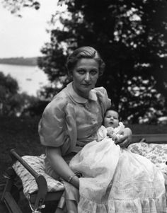 1938  Magda Goebbls with Baby Hedwig in the garden of her house in Schwanenwerder.
