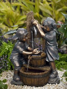 With a backwards cap and little girl pumping water, the kids playing water fountain will become a favorite.