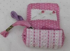 Small, very easy to make sewing case - can be made any size - and can be as fancy and decorative as you want. Would make a great gift.  This one features very decorative outer fabric embroidered in the Gingham embroidery / gingham lace / chicken scratch / Depression lace / Hoover lace / Amish lace / snowflake lace / broderie suisse style.
