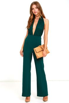 Whatever your request, the DJ is sure to listen when you're wearing the Keep Playing That Song Dark Green Halter Jumpsuit! This sexy woven poly jumpsuit has a lace-covered halter bodice with a plunging neckline and three-button closure at the neck. Seamed, wide-leg pants start at a fitted waistline and flare into a dance-floor dream! Hidden back zipper.