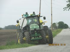 John Deere 8R Series tractor on E900 just  east of the CSX railroad tracks