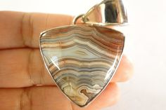 Mexican Crazy Lace Agate Solitaire 925 Sterling Silver Pendant      Item specifics   Condition: New without tags      :                A brand-new, unused, and unworn item (including handmade items) that is not in original packaging or may be missing original packaging materials (such as the original box...