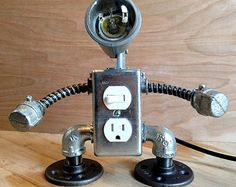 Handmade industrial robot lamp design with 4 functioning USB outlets and illuminated decora style switch. This lamp is handmade in my Brooklyn studio. (and is awesome)