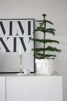 Homevialaura | Playtype calendar poster | Brass candle holder from Gauhar shop | diptyque | little christmas tree