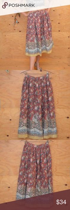 """Vintage 70's Skirt Midi Length Sweet Floral S DESCRIPTION: Comfy stylish 70's skirt. Floral pattern in, dusty rose, blue and tan. Midi length, fitted at waist, with gather, a-line cut, great for an urban boho hippie girl look.  CONDITION VERY GOOD~ Previously worn with moderate wash wear/fade, but no visible flaws. (see photos for details)  SIZE: Extra Small (see measurments)  ITEM MEASUREMENTS  Length: 32"""" Waist: 24"""" Hips: Open Skirts Midi"""