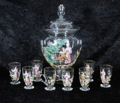 9 PC. EUROPEAN GLASS PUNCH SET. CONSISTING OF A COVERED PEDESTGAL BOWL W/ 8 MUGS.  MULTI-COLOR ENAMEL FIGURAL DECORATION. PUNCH BOWL 16 H - MUGS 4 H