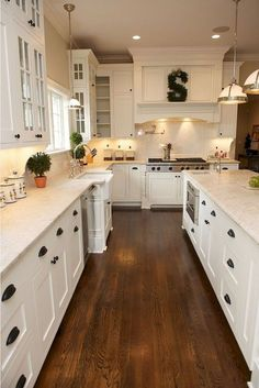 This is a traditional kitchen with contemporary features. Painted white, shaker … This is a traditional kitchen with contemporary features. White Kitchen Cabinets, Kitchen Cabinet Design, Kitchen Redo, Kitchen Interior, New Kitchen, Wall Cabinets, Kitchen Ideas, White Cupboards, Cheap Kitchen