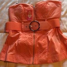 SALE Perfect Summer Top I bought the wrong size on another site and can't return it so passing it along. Great coral color perfect for summer with matching belt. Top slightly padded and zippered front. Super cute!  2b by Bebe bebe Tops